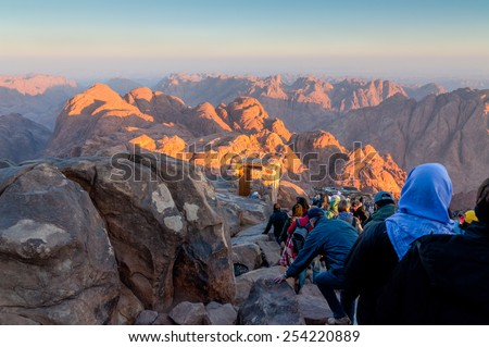 MOUNT SINAI, EGYPT - NOVEMBER 25: Pilgrims and tourists on the pathway from the Mount Sinai peak (Holy Mount Moses) in early morning on November 25, 2010, Egypt.  - stock photo