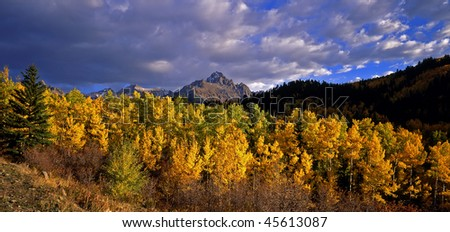 Mount Sneffels with aspen trees in thr foreground, located in the Uncompahgre National Forest of Colorado, photographed during the autumn season.. - stock photo