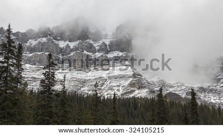 Mount Temple in white clouds near Moraine lake, Banff national park, Alberta, Canada - stock photo