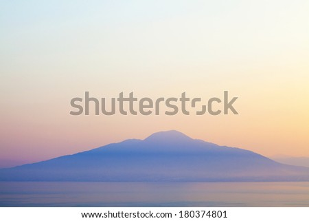 Mount Vesuvius and Bay of Naples at sunrise. Photographed from the mountains of Sorrento. - stock photo