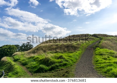mount wellington peak view in auckland, new zealand with trails leading to the peak top. - stock photo