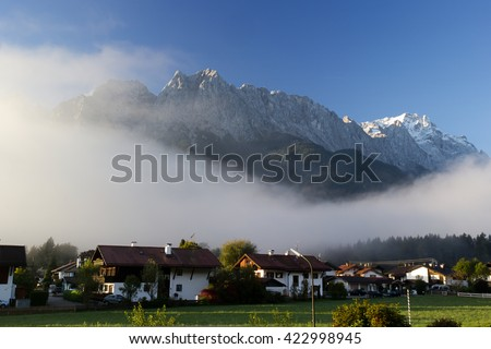 Mount Zugspitze in beautiful mist and clouds (Alps, Bavaria, Germany)