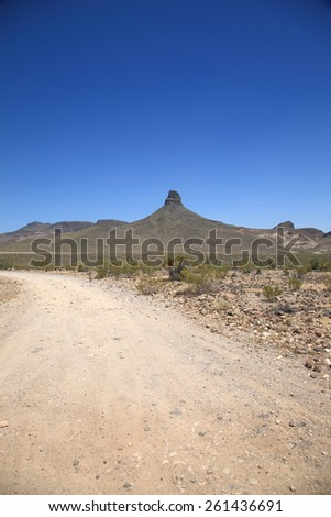 Mountain and Desert Landscape - Dirt road in the American Southwest. - stock photo
