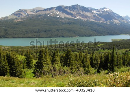 mountain and lake in glacier national park, montana, usa - stock photo