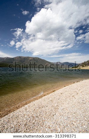 Mountain and Lake landscape with Fall colors on Hebgen Lake, Montana. - stock photo