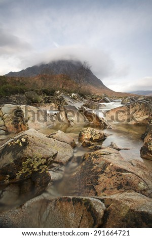 mountain and stream at glen etive moor in scotland - stock photo
