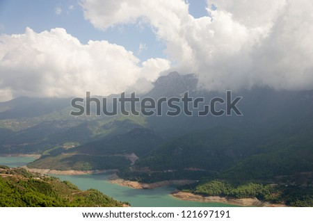 Mountain at water reservoir at hot noon