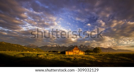 Mountain barn just after dawn - stock photo