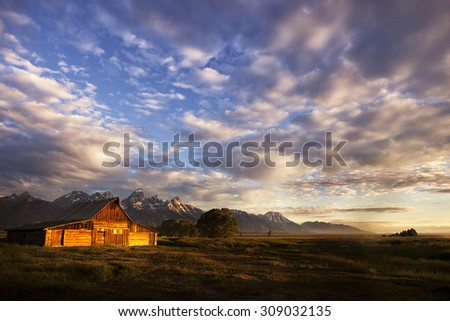 Mountain barn just after dawn