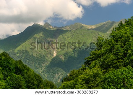 Mountain. Beautiful mountain landscape, Mountain peak. Mountain in clouds. Mountain forest. View of mountain peak and blue sky. Mountain under sunlight. Amazing mountain in clouds. Sochi, Russia - stock photo