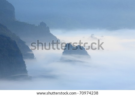 Mountain between clouds in morning - stock photo