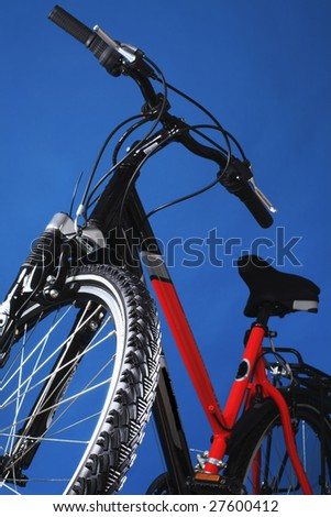 Mountain bicycle on a dark blue background - stock photo