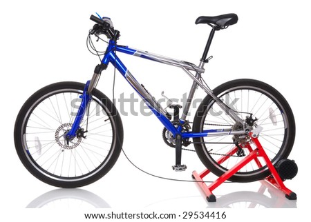 Mountain bicycle with cycletrainer on white background