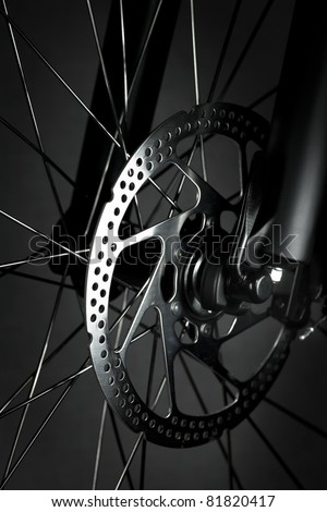 Mountain bike front wheel with mechanical disc brake - stock photo