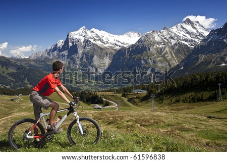 Mountain Bike in the alps in front of mountains