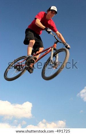 Mountain bike jump - stock photo