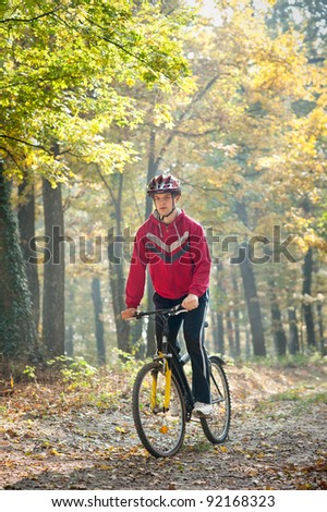 mountain bike race in a forest - stock photo