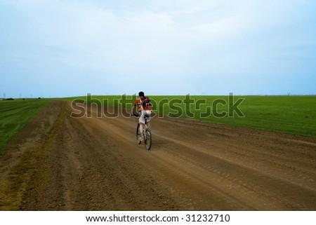mountain bike race on ground road - stock photo