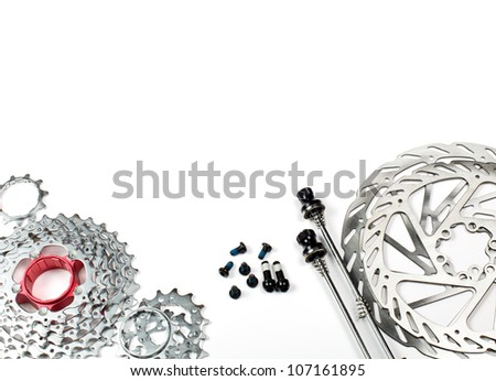 Mountain bike rear cassette, bolts, skewers and disk rotors on white background - stock photo