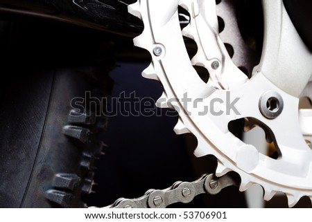 Mountain bike's gear and chain on crank set - stock photo