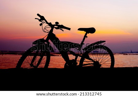 Mountain bike silhouette with sunset sky, Thailand - stock photo