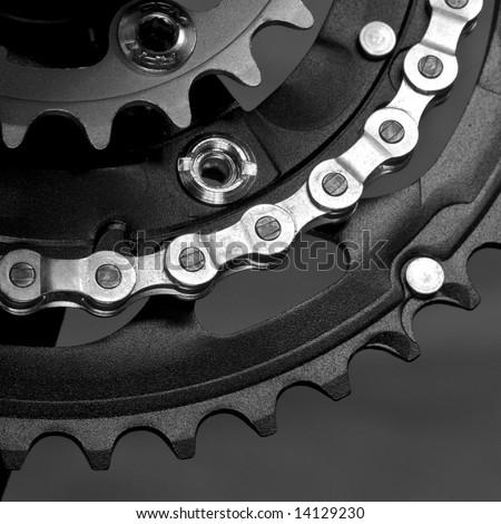 Mountain bike three chainring crankset with  chain black&white - stock photo