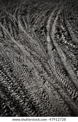 Mountain Bike Tracks in Mud Background - stock photo