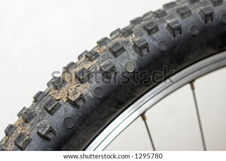 mountain bike tyre with mud on - stock photo