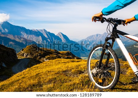 Mountain bike wheel and sommer alpine  landscape - stock photo
