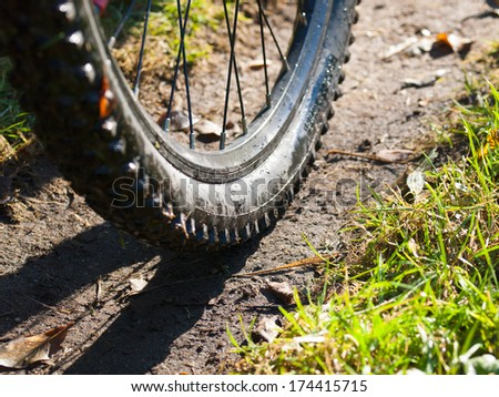 Mountain bike wheel detail in nature - stock photo