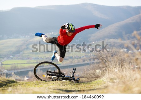 Mountain Biker has a painful looking crash with his bike - stock photo