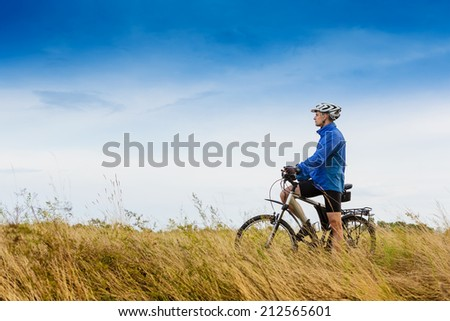 Mountain biker in the meadow. travel sport lifestyle concept