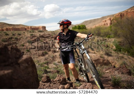 Mountain biker in wild desert canyon