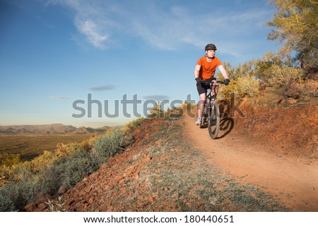 Mountain Biker on Desert Trail  - stock photo