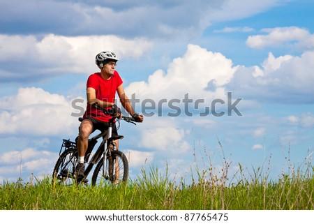 mountain biker on sunny day - stock photo