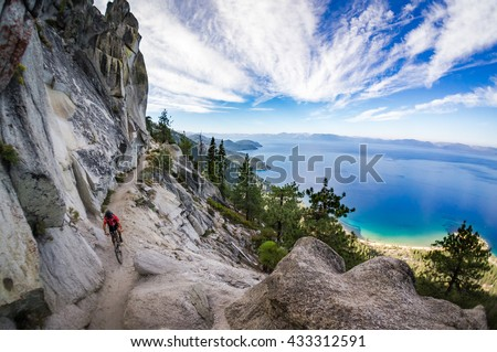 Mountain biker on the Flume Trail at Lake Tahoe, CA. - stock photo