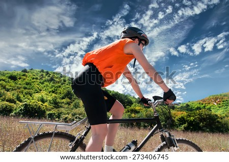 Mountain Biker with  background of blue sky - stock photo