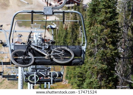 Mountain Bikes on Chairlift - stock photo