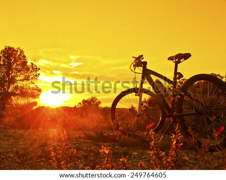 mountain biking at sunrise - stock photo