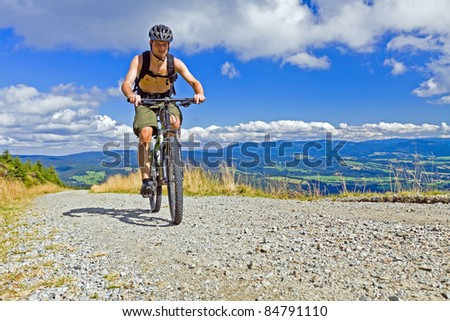 Mountain biking in summer mountains - stock photo