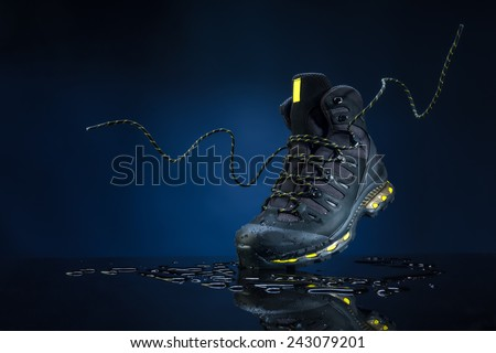 mountain boots on a dark background - stock photo