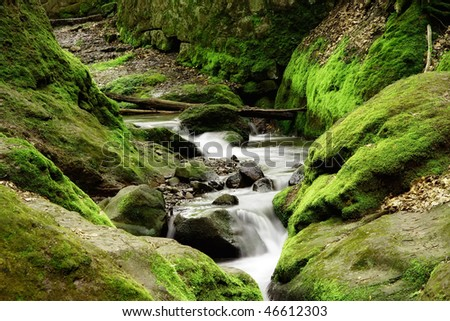mountain brook with moss and stones - stock photo