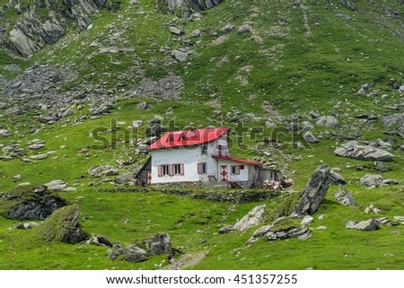Mountain cabin in Carpathians mountains in the summer season - stock photo
