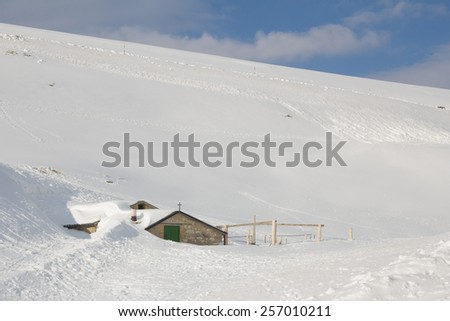 Mountain chalet in the italian alps - stock photo
