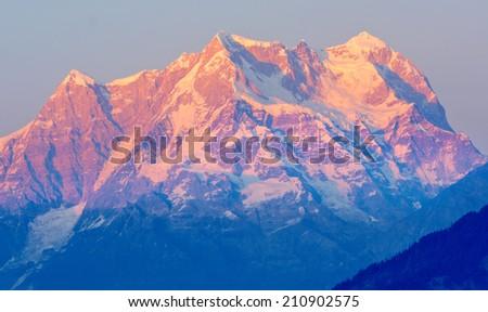 "Mountain ""Chaukhambha"" during early Sunset In Himalaya - stock photo"