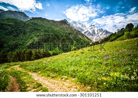 Mountain Cheget and view of snow-capped peaks of Mount Donguzorun, Kabardino-Balkaria Republic, Russia. Caucasus Mountains - stock photo