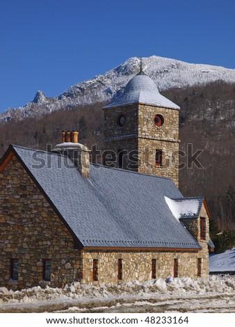 mountain church in winter - stock photo