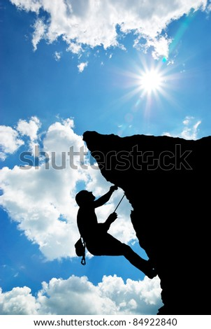 Mountain climber on the top. - stock photo