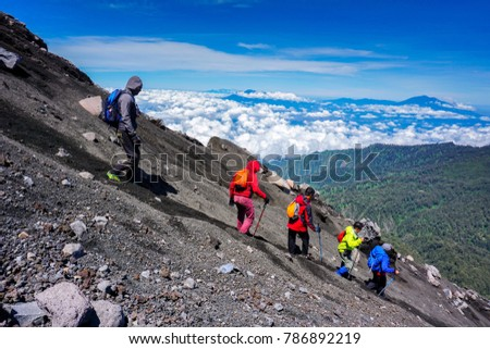 mountain climbers go down from semeru mountain
