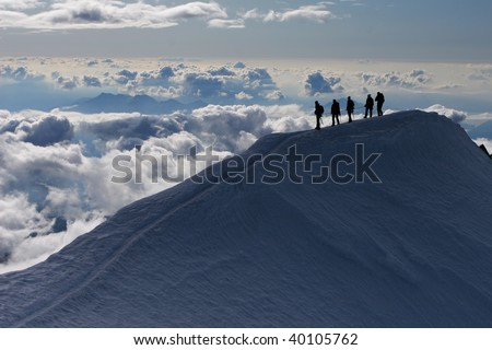 Mountain climbing - stock photo